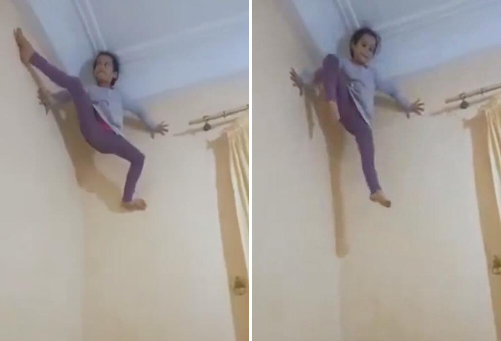 国外一五岁女孩用手脚蹬墙壁爬到房顶 被称蜘蛛女孩